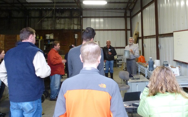 Poultry and equipment discussion in the barn